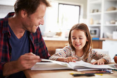 Father home schooling his young daughter royalty free stock image