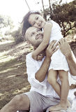 Father hugging daughter. Father hugging his daughter outdoors in a park stock photos