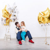 Father hugging daughter. Family celebration. Stock Photo
