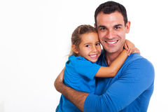 Father hugging daughter. Happy father hugging his daughter over white background royalty free stock images