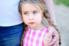 Father hugging little adorable sad daughter. Outdoor Stock Images