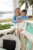 Father hugging tween son Stock Photo