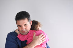 Father hugs his daughter. Parenting, fatherhood children and family concept. copy space stock photography