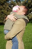 father hugs his little daughter Stock Photos
