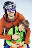 Father hugs his son affectionately in the snow. In mountain Royalty Free Stock Photos