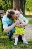 Father hugs a little daughter in a yellow dress. Father hugging little daughter in yellow dress in park stock photography