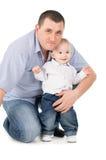 Father hugs little son Stock Photos