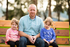Father With Identical Twin Daughters Stock Images