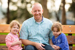 Father With Identical Twin Daughters Stock Photo