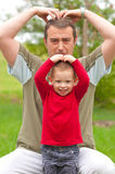 Father imitates his son Royalty Free Stock Image