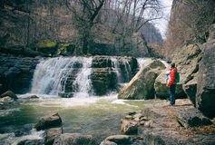 Father with infant baby in baby carrier near waterfall Royalty Free Stock Photography