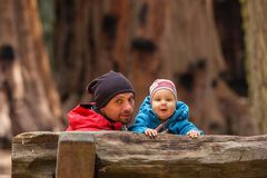 Father with infant son visit Sequoia national park in California, USA.  stock photos