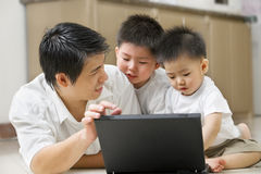 Father introduce technology to his sons Stock Photos