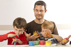 Father ist painting with his kids Stock Images