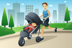 Father jogging while pushing a stroller Royalty Free Stock Images