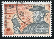 Father Joseph Damien. RUSSIA KALININGRAD, 19 OCTOBER 2015: stamp printed by Belgium, shows Father Joseph Damien, circa 1964 Stock Image