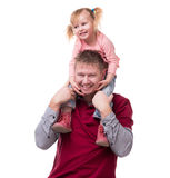 Father keeping daughter on his shouldes Stock Photo