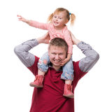 Father keeping daughter on his shouldes Stock Photos