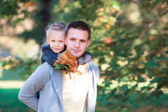 Father and kid in autumn park at warm day Royalty Free Stock Photos