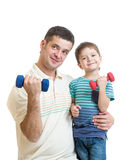 Father and kid boy doing exercise with dumbbells together Royalty Free Stock Image