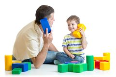 Father and kid boy role play. Dad and child kid boy role play together isolated on white Royalty Free Stock Photo