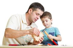 Father and kid child working together Stock Photo