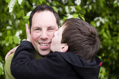 Father and kid love. Kid son kiss father love of parent Stock Photo