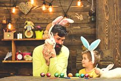 Father and kid painting Easter eggs. royalty free stock photos