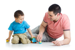 Father and kid play with car toys together Royalty Free Stock Images
