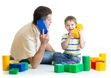 Father and kid play and improvise together Royalty Free Stock Photography