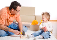 Father and kid playing Royalty Free Stock Photos