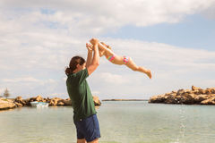 Father and kid playing on the beach. Royalty Free Stock Image