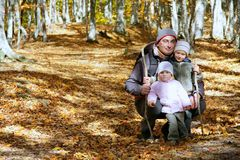 Father and kids in autumn forest Stock Photography