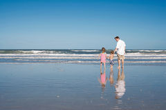 Father and kids on a beach Royalty Free Stock Photo