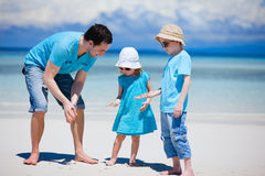 Father and kids at beach Royalty Free Stock Photos