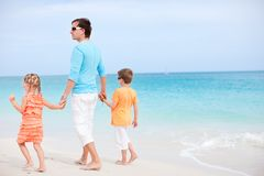 Father and kids at beach Stock Photography