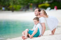 Father and kids on a beach Stock Images