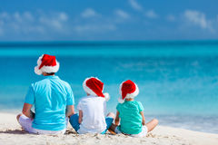 Father with kids at beach on Christmas royalty free stock photo