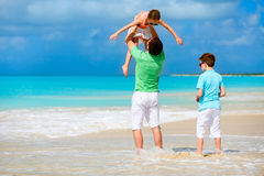 Father with kids at beach Stock Photo