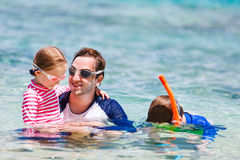Father with kids at beach Royalty Free Stock Photography