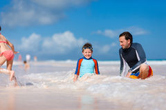 Father with kids at beach Stock Image
