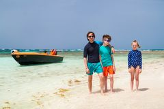 Father with kids at beach. Father and kids enjoying beach vacation on tropical island royalty free stock images