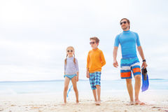 Father with kids at beach Royalty Free Stock Images