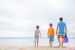 Father with kids at beach Royalty Free Stock Photos