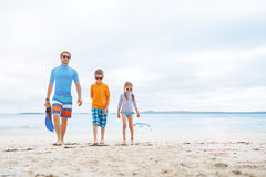 Father with kids at beach Royalty Free Stock Image