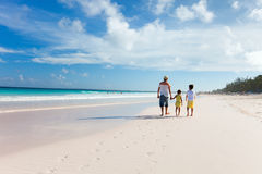 Father with kids at beach Stock Photos