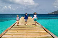 Father with kids in Caribbean. Father and kids enjoying summer vacation on tropical island in Caribbean royalty free stock photo