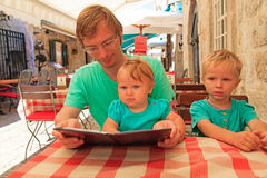 Father with kids in city cafe on summer day Royalty Free Stock Images