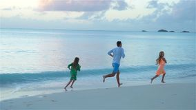Father and kids enjoying beach summer tropical vacation. SLOW MOTION stock video footage