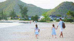 Father and kids enjoying beach summer tropical vacation stock video